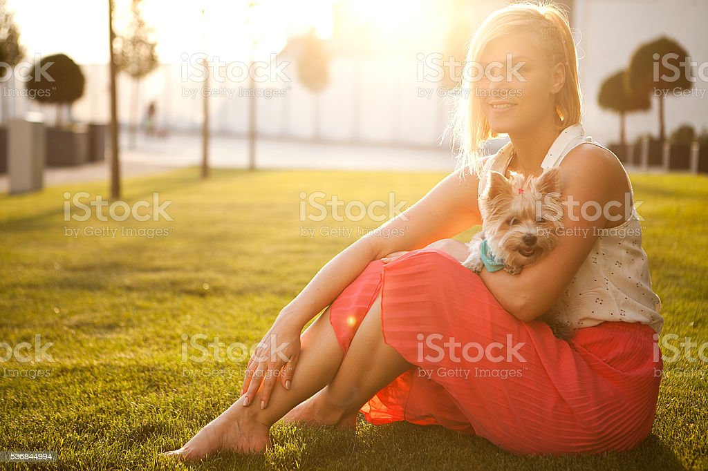 Portrait of girl and dog at meadow stock photo