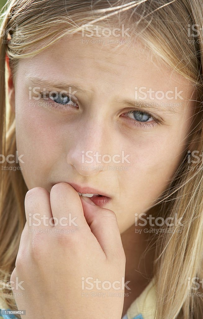 Portrait Of Girl Biting Nails royalty-free stock photo
