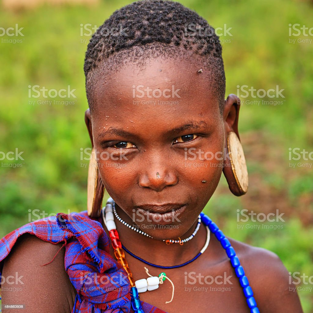 Portrait of girl from Mursi tribe, Ethiopia, Africa stock photo