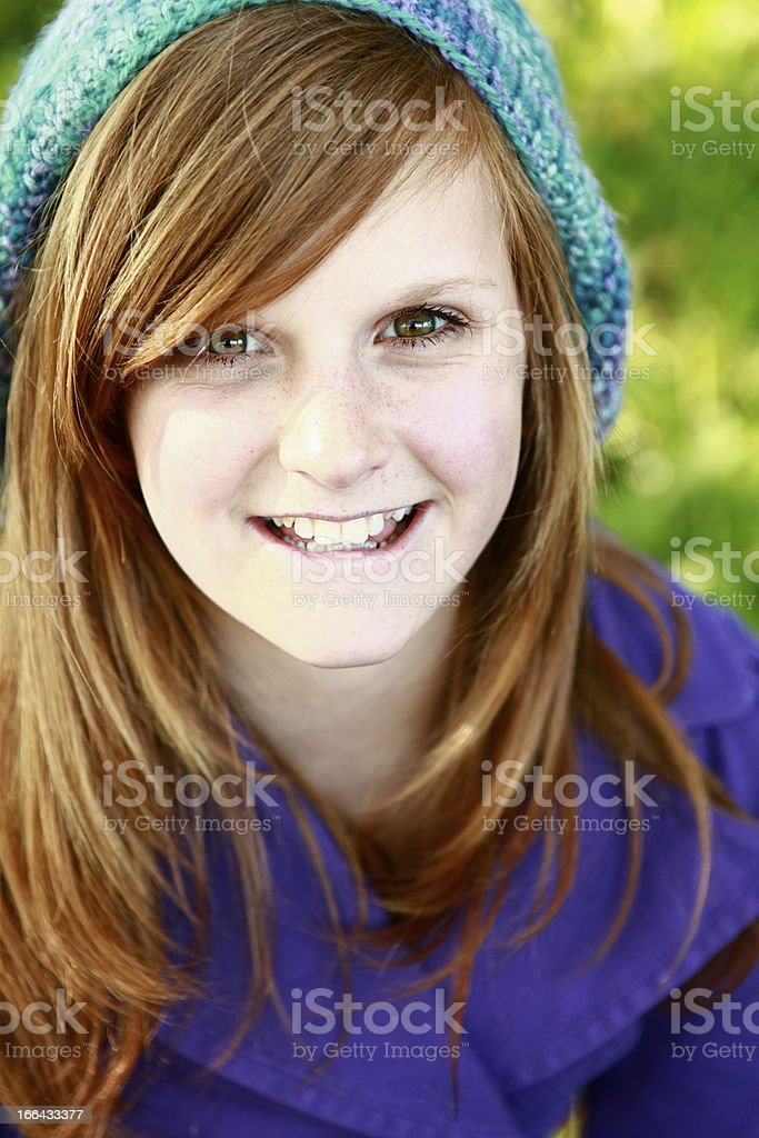 Portrait of girl in blue beanie and purple coat royalty-free stock photo