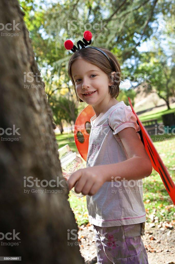 Portrait Of Girl In Ladybug Costume stock photo