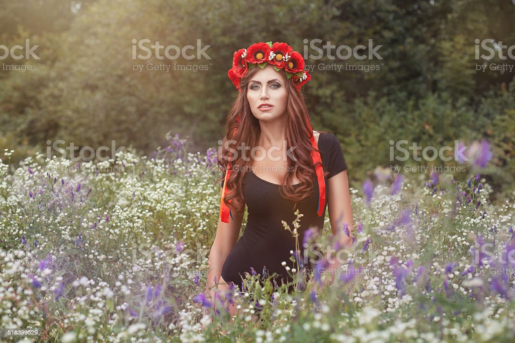 Portrait of girl in wild flowers. stock photo