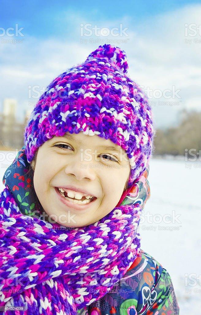 Portrait of girl in winter park stock photo