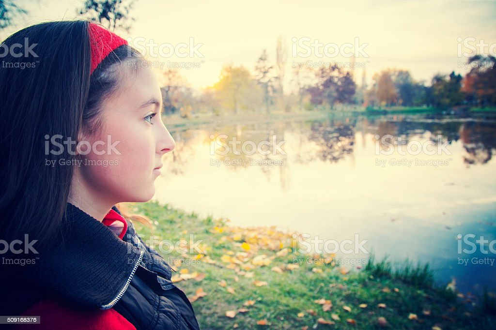 Portrait of girl looking away against sunset royalty-free stock photo