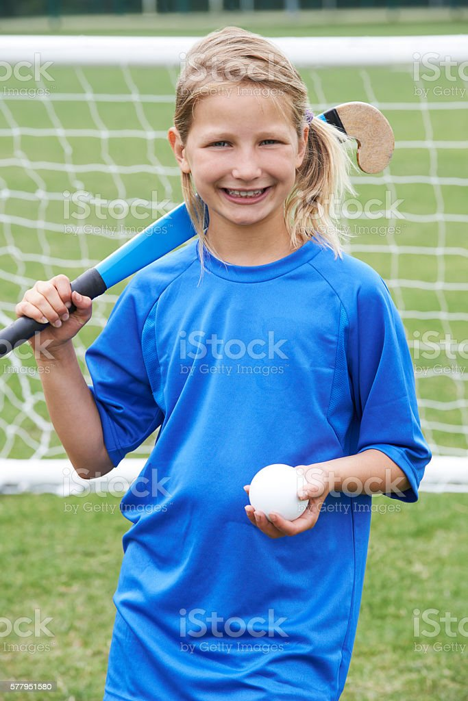Portrait Of Girl Playing Hockey At School stock photo