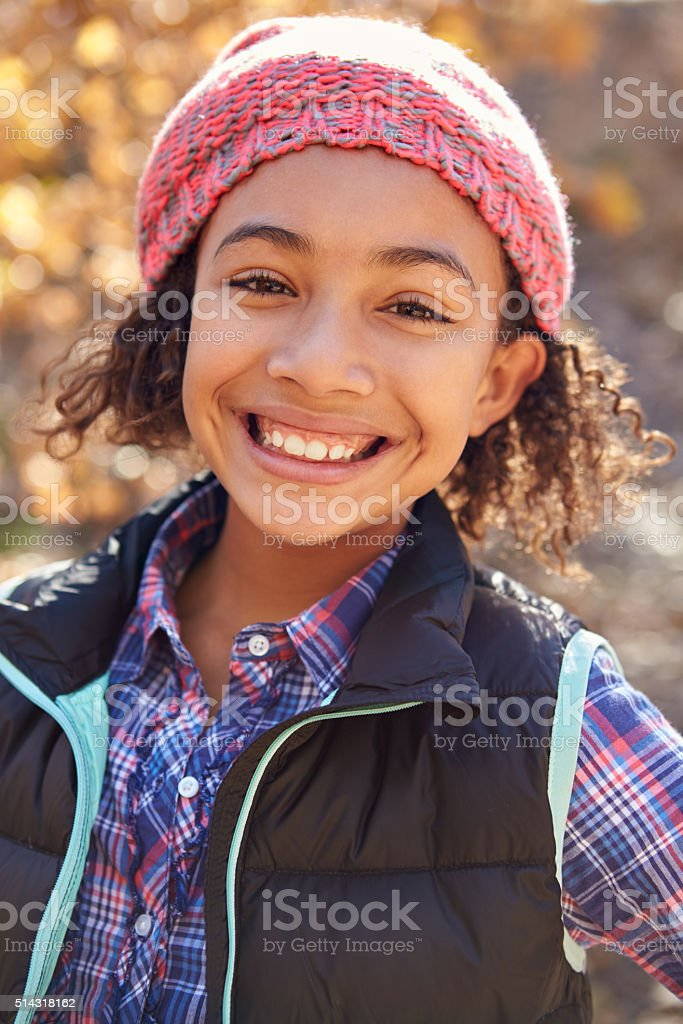 Portrait Of Girl Playing In Autumn Woods stock photo
