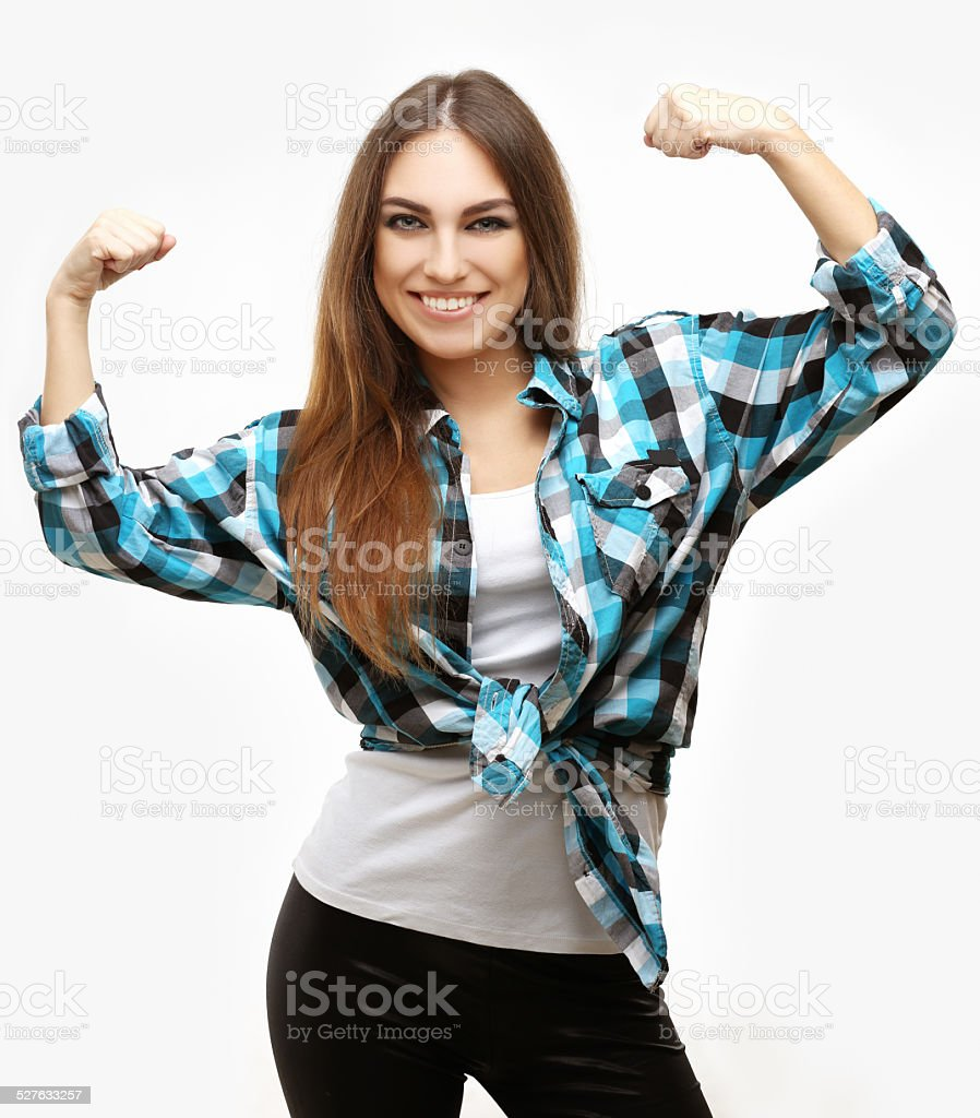 Portrait of girl tightens her fist, looking at camera. stock photo