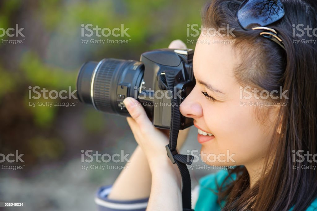 portrait of girl with camera stock photo