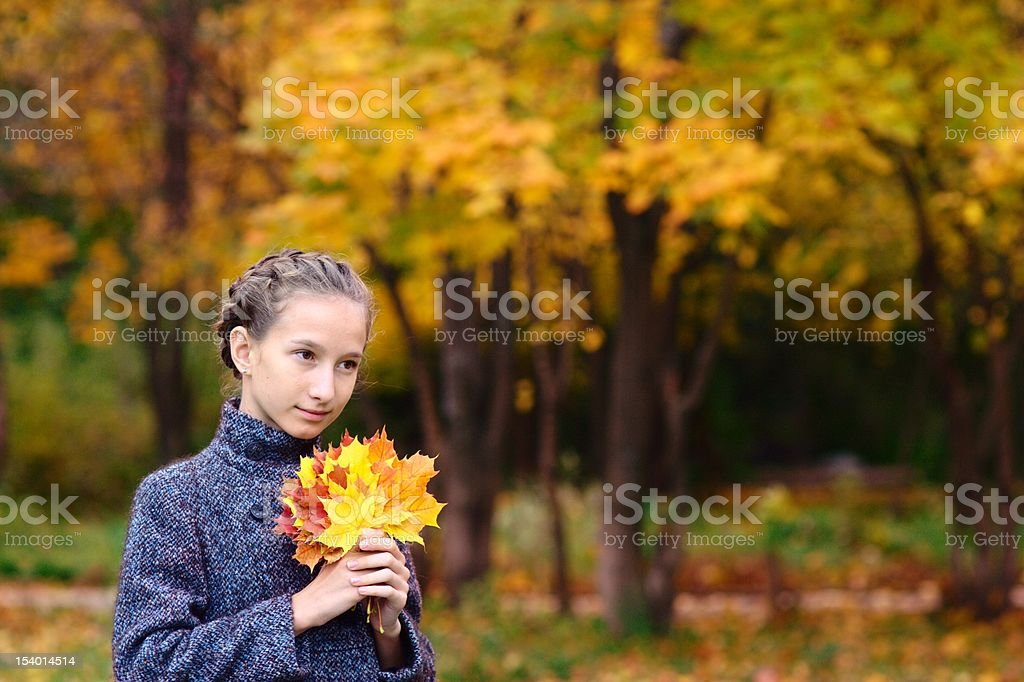 Portrait of Girl with maple leaves stock photo