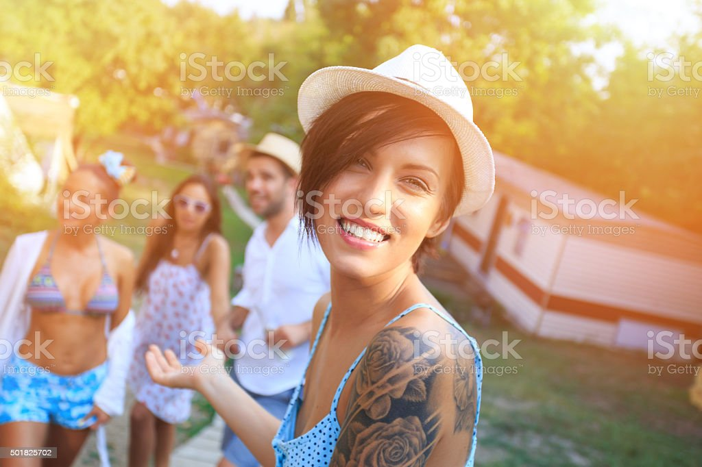 Portrait of girl with tatoo and hat stock photo