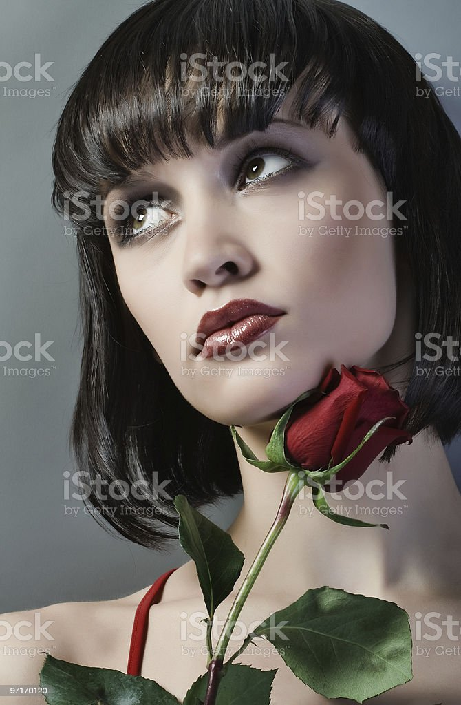 Portrait of girl with the red flower. stock photo