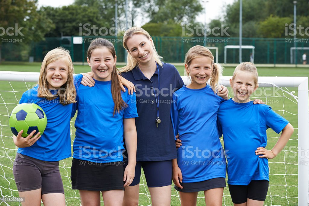 Portrait Of Girl's Soccer Team With Coach stock photo