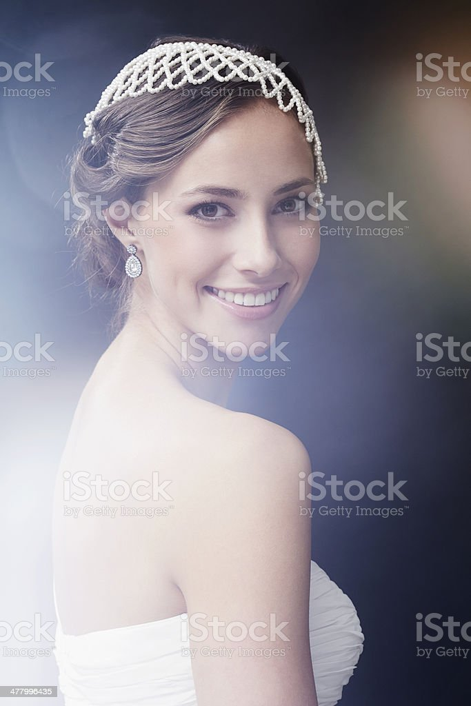 Portrait of glamorous young bride smiling, studio shot royalty-free stock photo