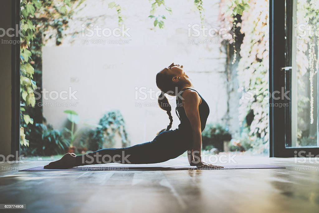 Portrait of gorgeous young woman practicing yoga indoor. Beautiful girl stock photo