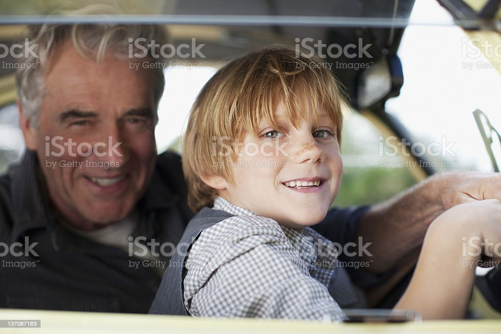 Portrait of grandfather and grandson in car royalty-free stock photo