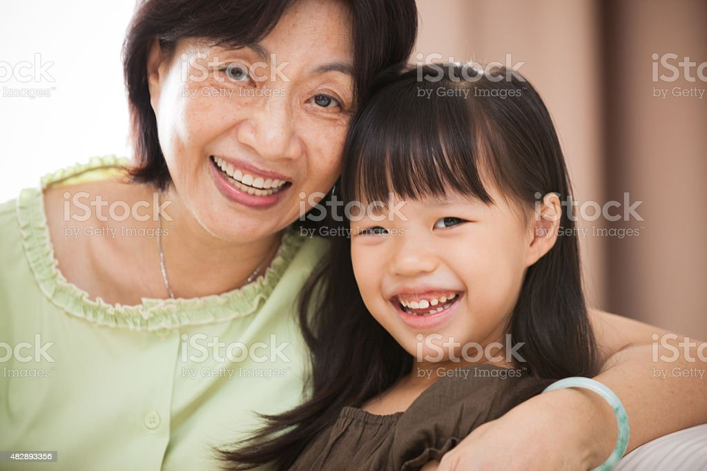 Portrait of Grandmother and Granddaughter Smiling stock photo