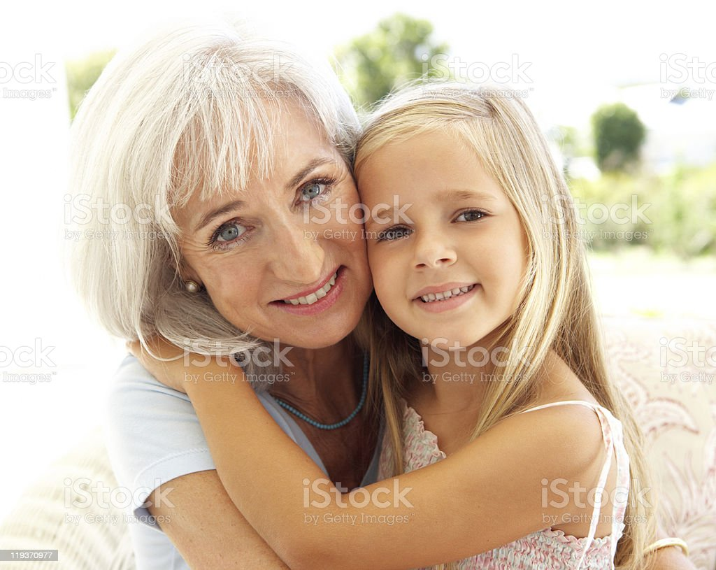 Portrait Of Grandmother With Granddaughter Relaxing Together stock photo
