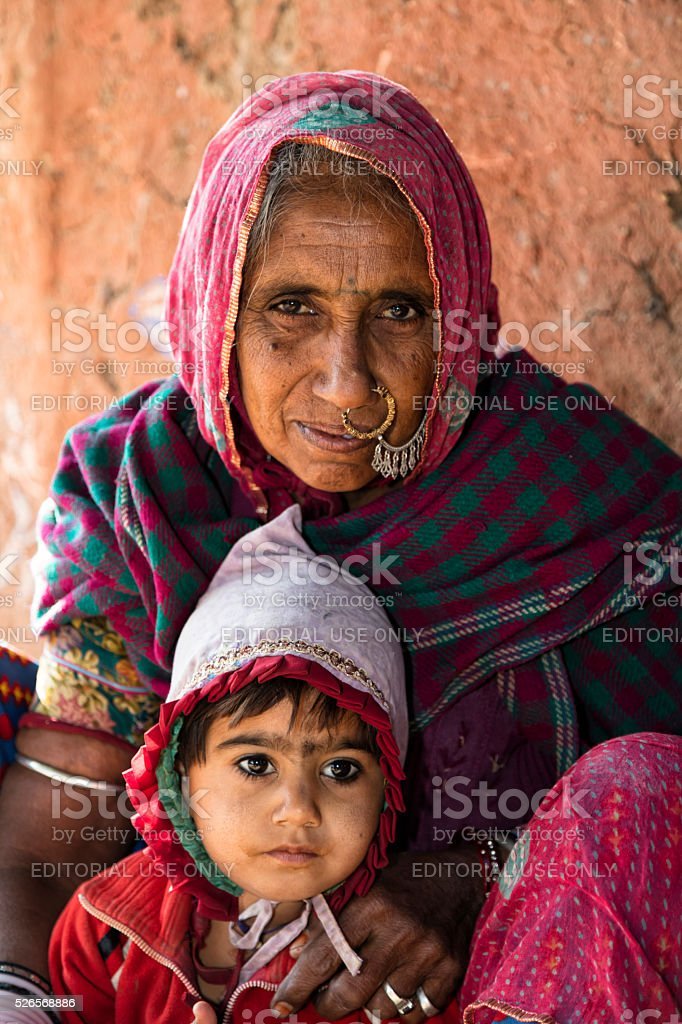 Portrait of grandmother with her small grandson, Bishnoi, Rajasthan, India stock photo