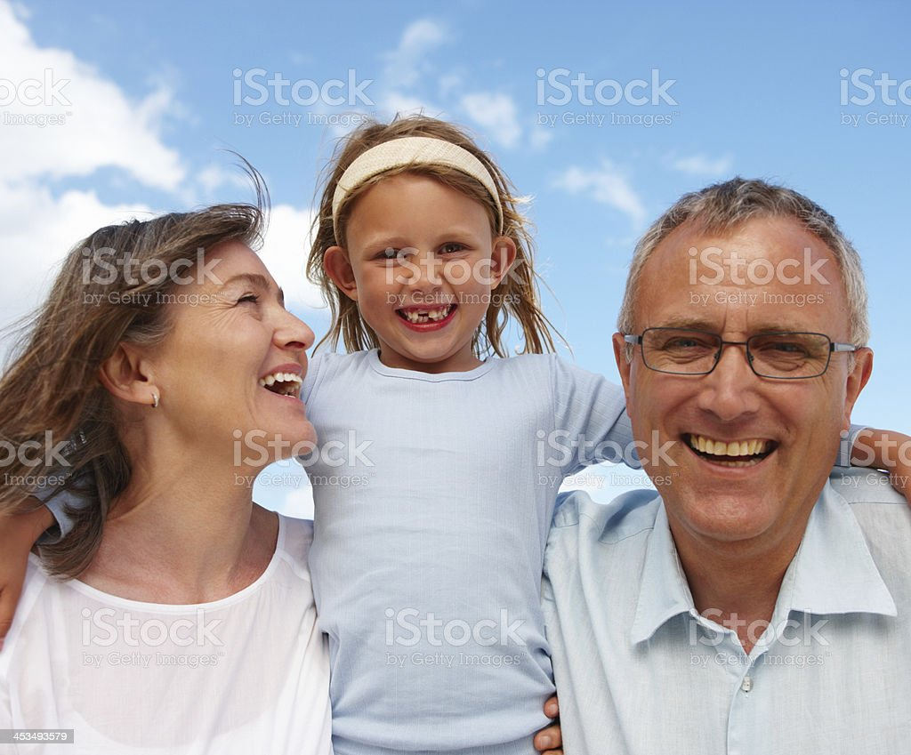 Portrait of grandparents with granddaughter having fun royalty-free stock photo