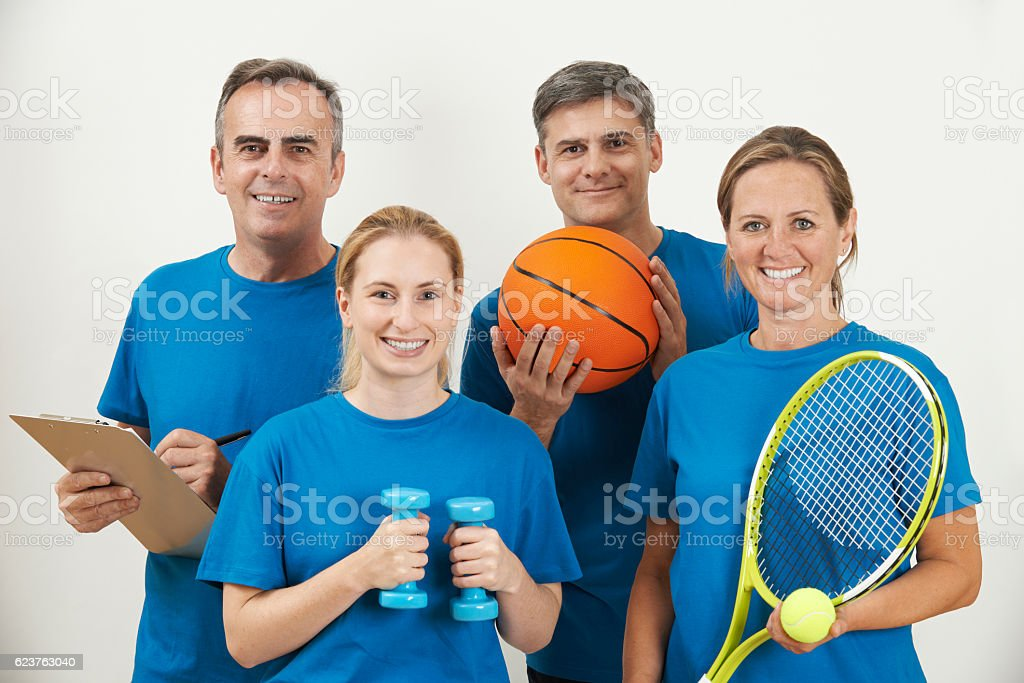 Portrait Of Gym Staff Against White Background stock photo