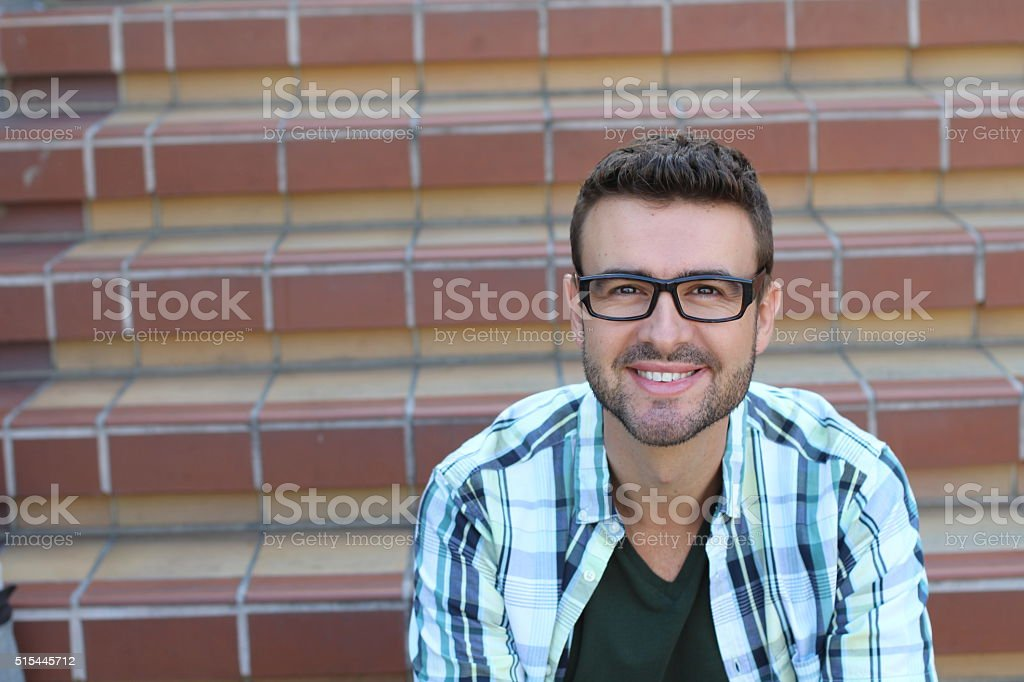 Portrait of handsome 30-year-old man with glasses stock photo