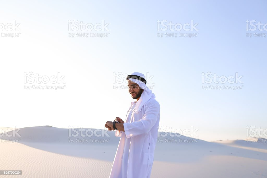 Portrait of handsome Arab businessman who experiencing new iWatc stock photo