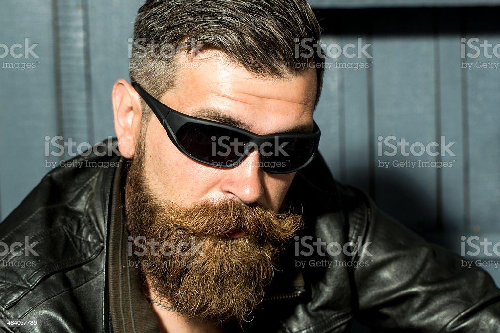 Portrait of handsome biker stock photo