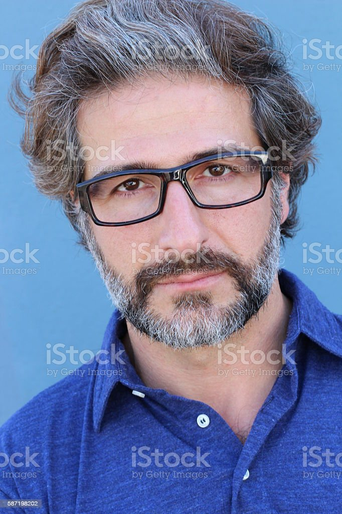 Portrait of handsome businessman wearing glasses stock photo