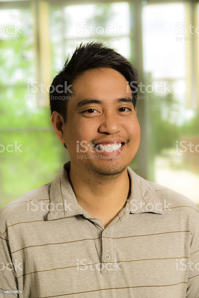 Portrait of handsome, Cambodian descent young adult man. stock photo