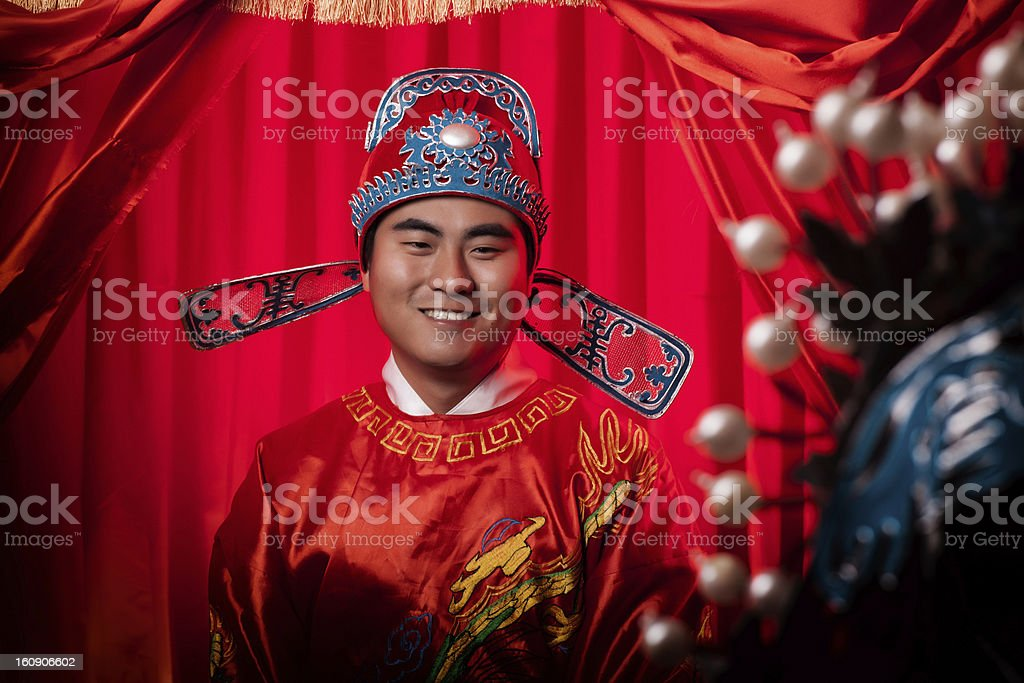 Portrait of  Handsome Chinese Groom dressing in traditional wedding clothes royalty-free stock photo