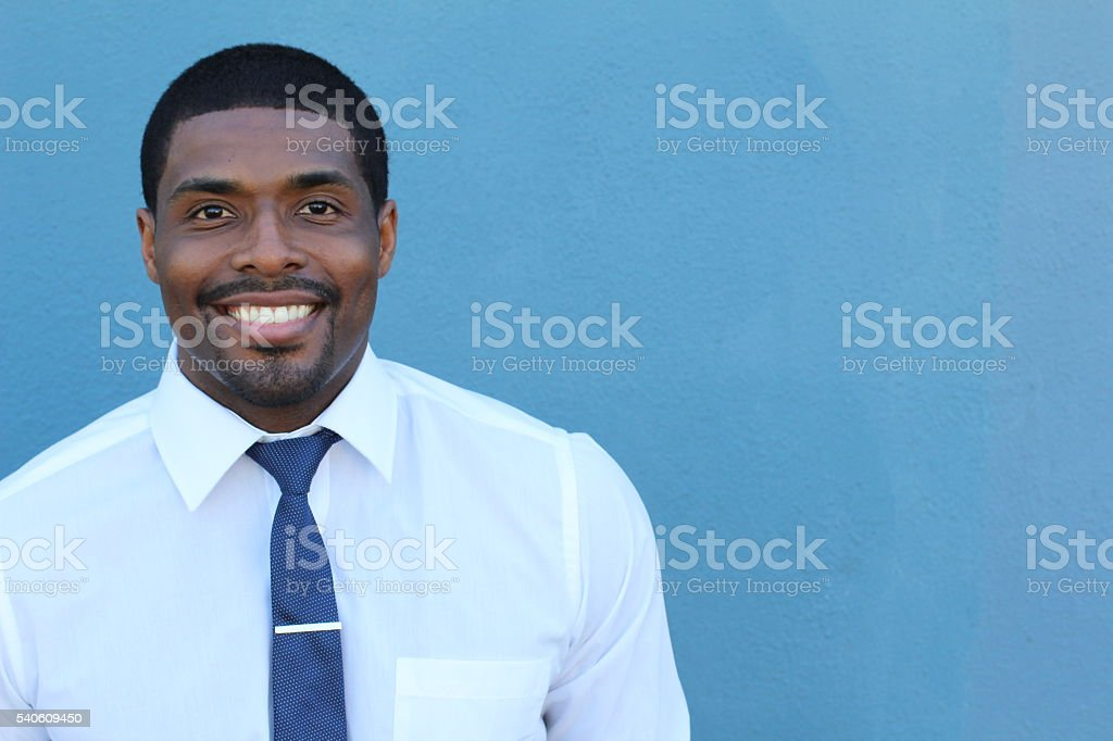 Portrait of handsome confident young African businessman stock photo
