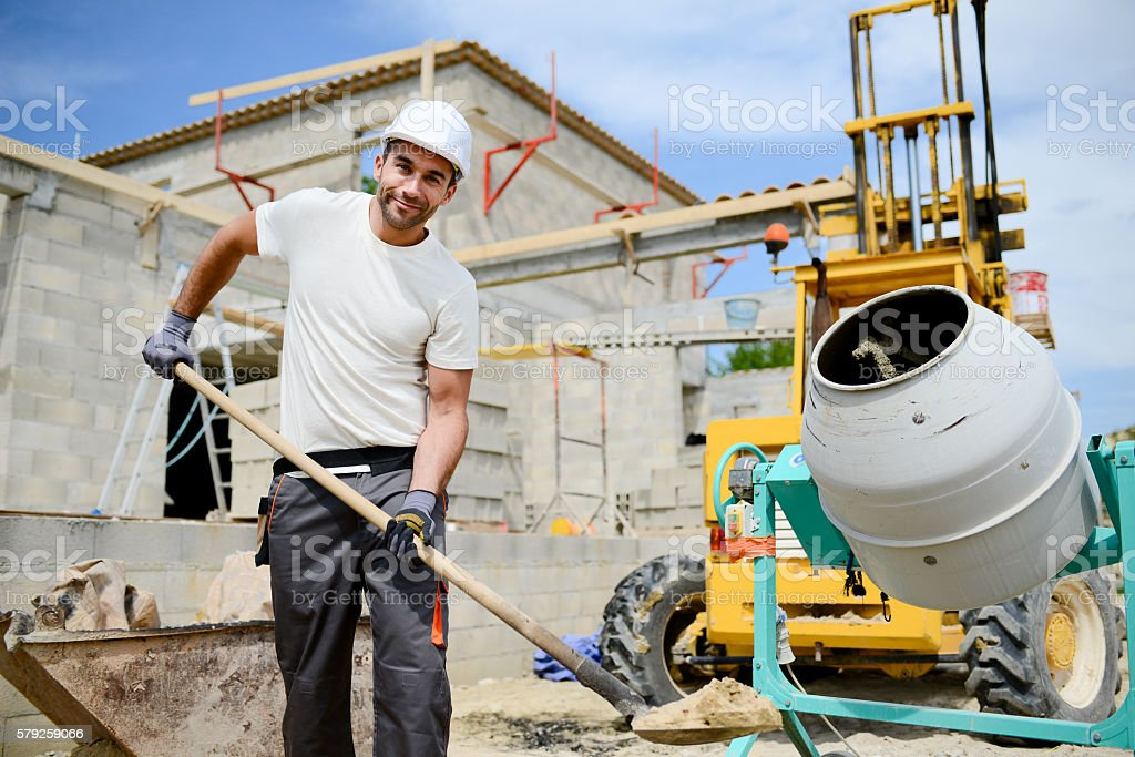portrait of handsome construction worker on building industry construction site stock photo