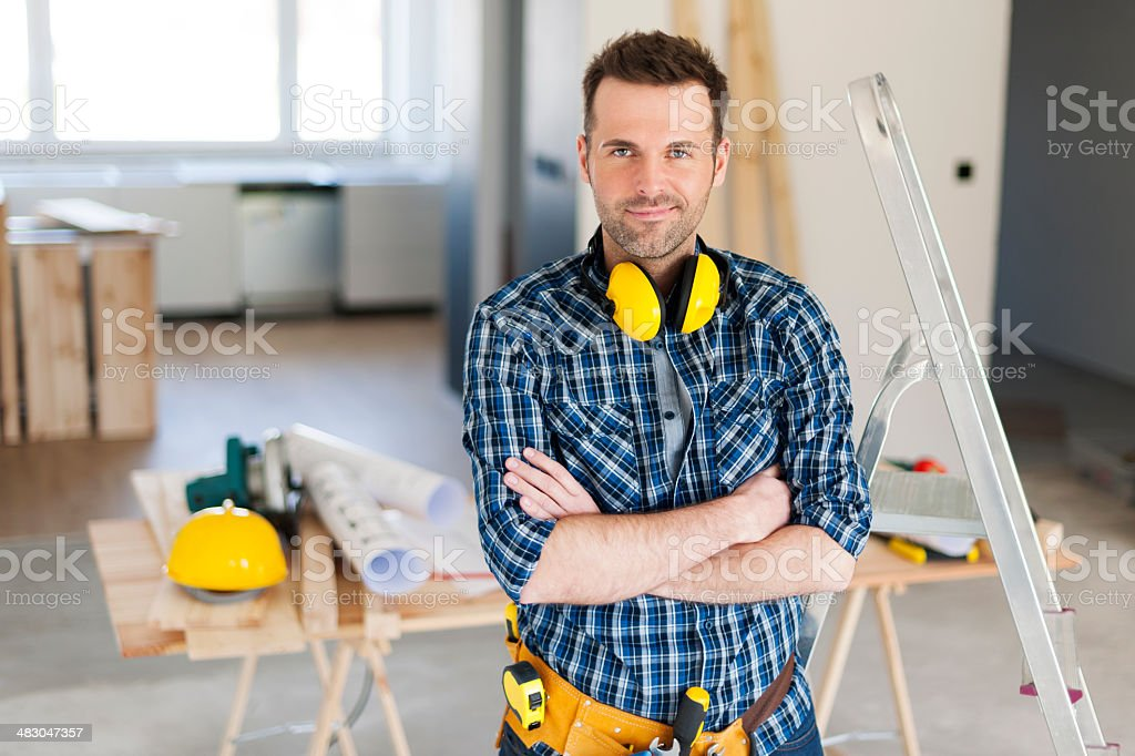 Portrait of handsome construction worker stock photo