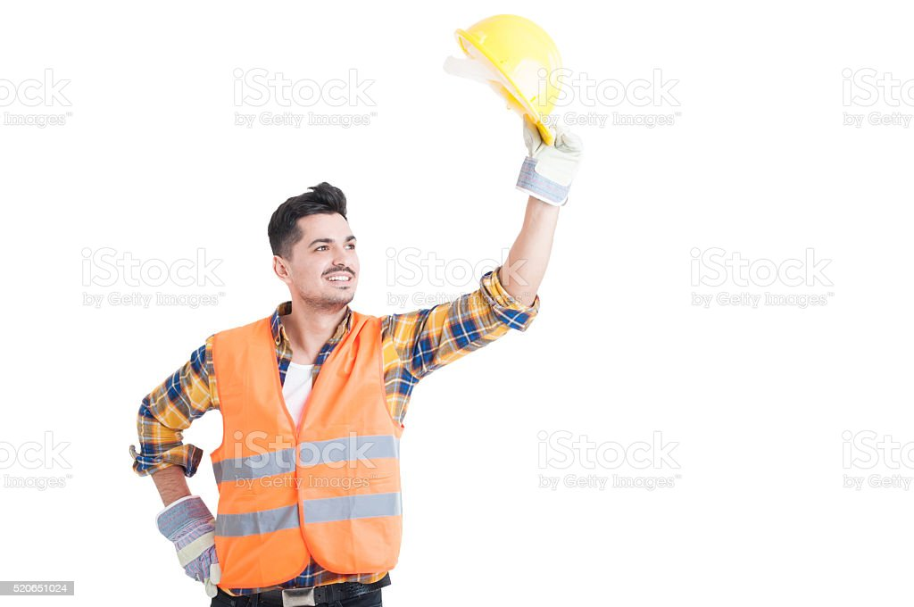 Portrait of handsome constructor or engineer raise his helmet up stock photo