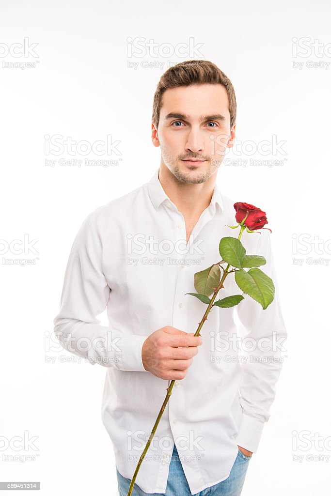Portrait of handsome cute sexy boy with red rose stock photo