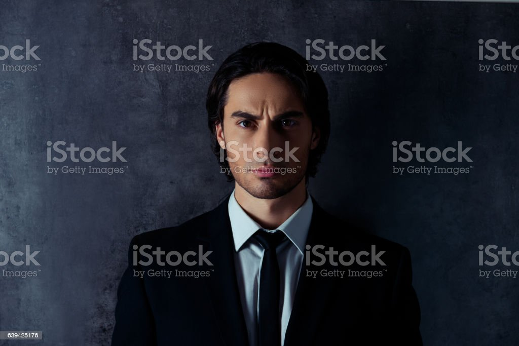 Portrait of handsome hispanic businessman isolated on gray background stock photo