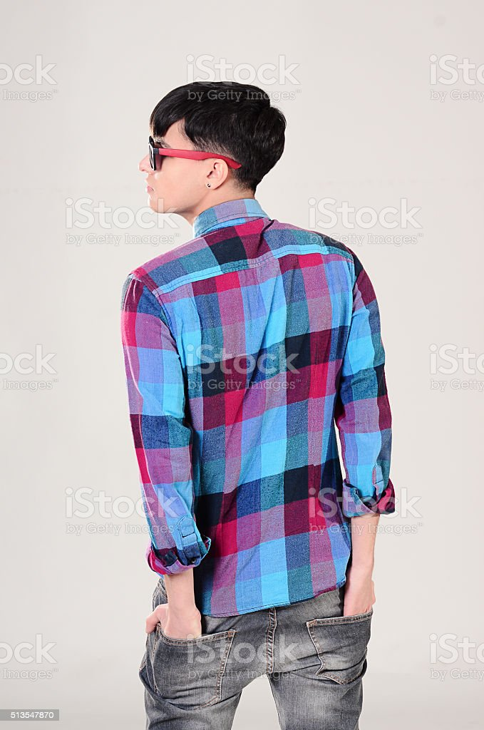 Portrait of handsome man in plaid shirt and jeans clothing stock photo
