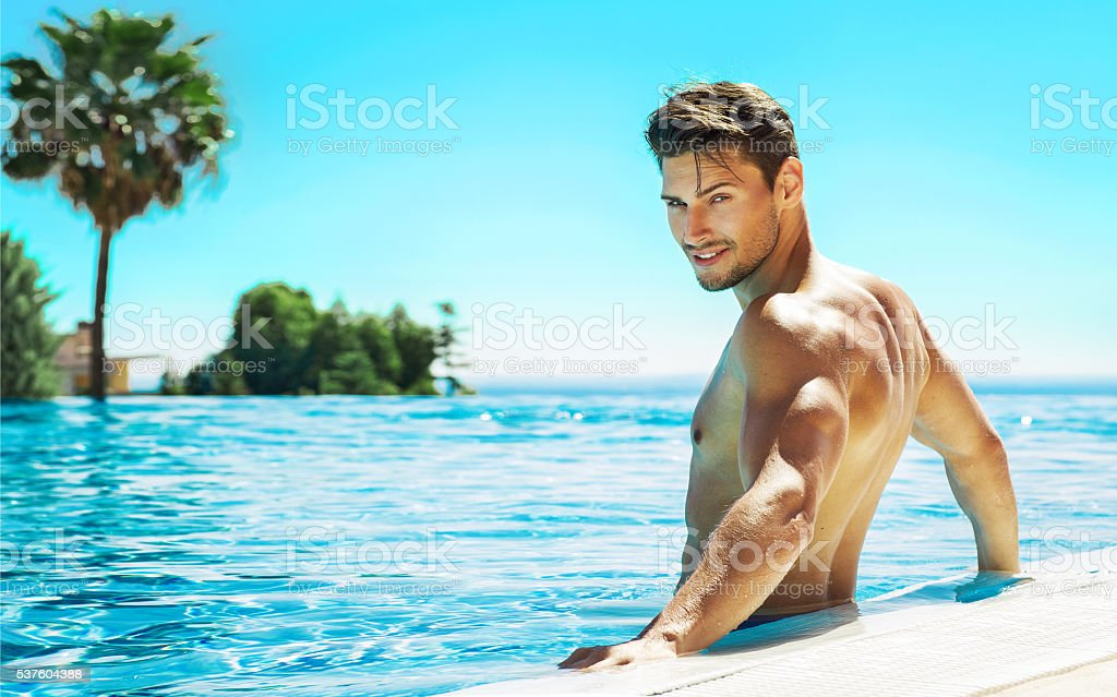 Portrait of handsome man in swimming pool stock photo