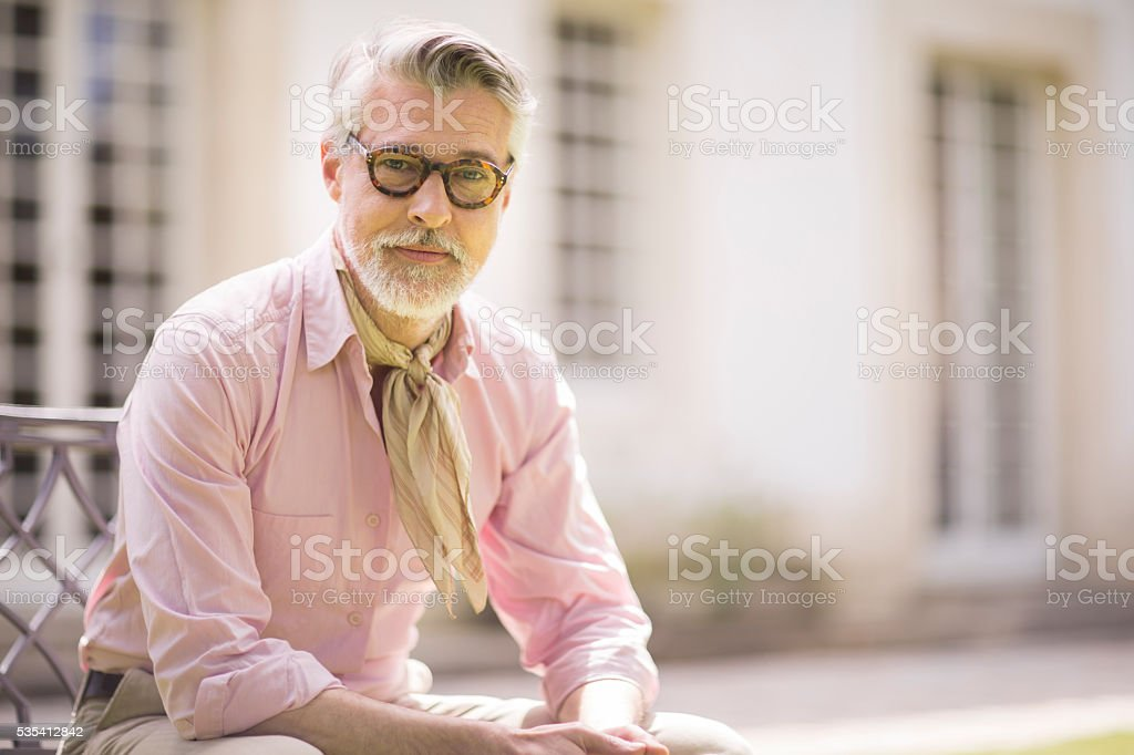 Portrait of handsome man looking at camera. stock photo