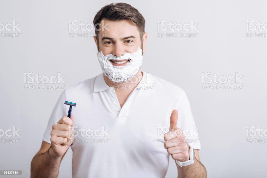 Portrait of handsome man posing with razor stock photo