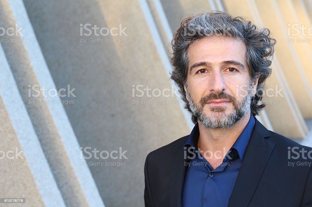 Portrait of handsome man with grey hair stock photo