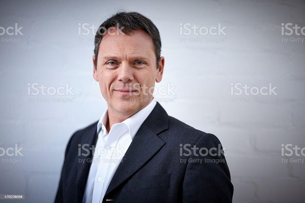 Portrait of handsome mature businessman stock photo