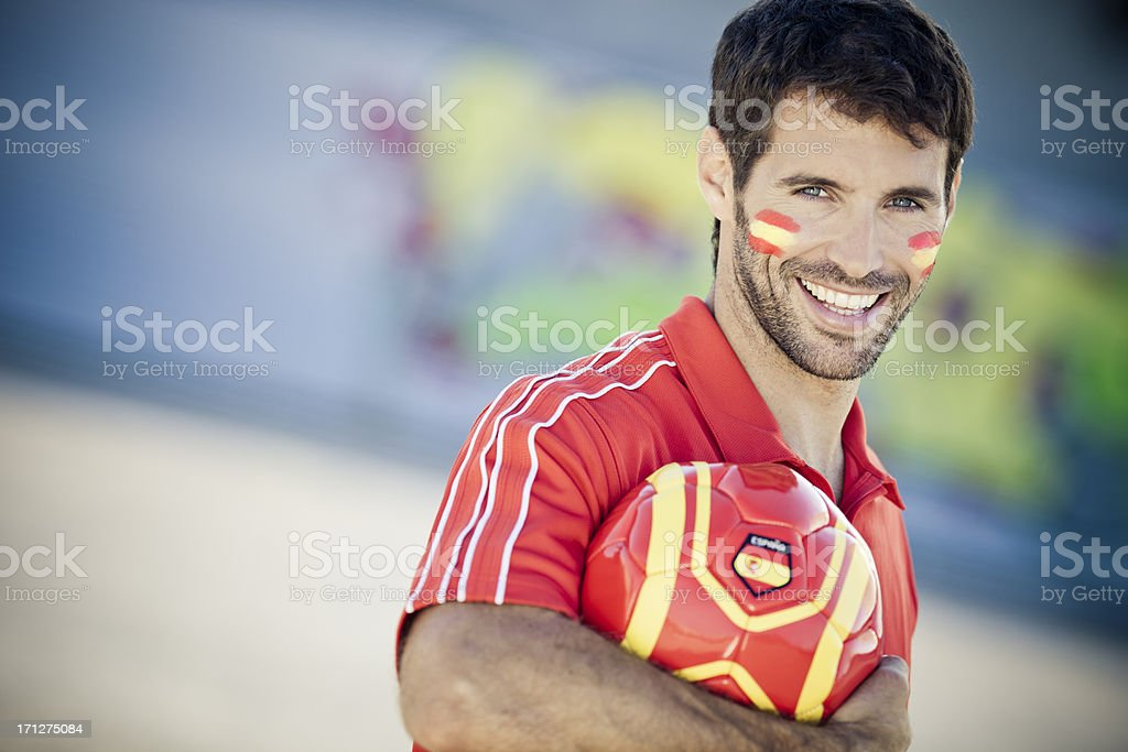 portrait of handsome men as spanish football fan stock photo