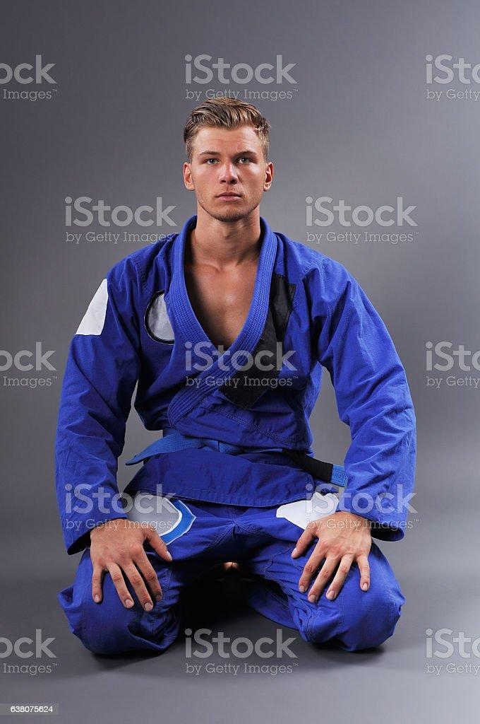 Portrait of Handsome Muscular Jiu Jitsu Fighter Posing. stock photo