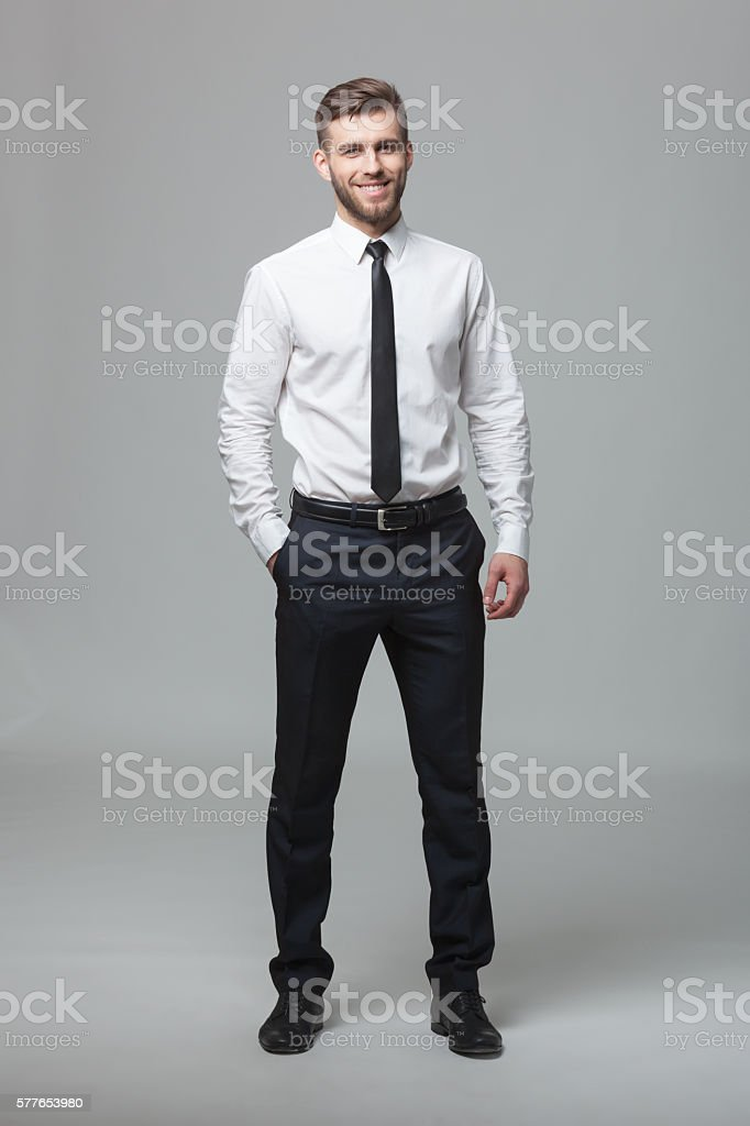 Portrait of handsome young businessman on white background. stock photo