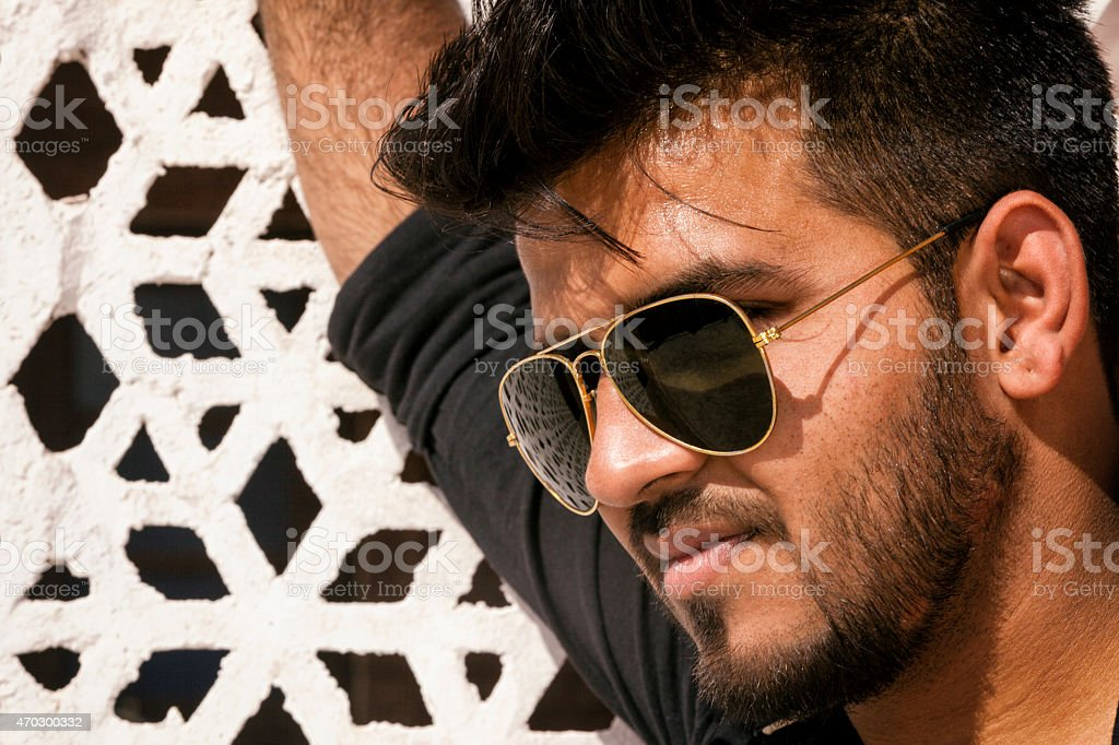 Portrait of Handsome Young Indian Man Wearing Sunglasses stock photo