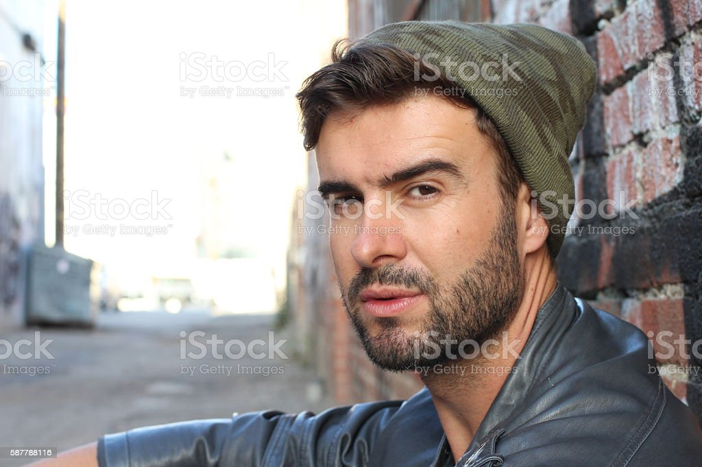 Portrait of handsome young man urban stock photo