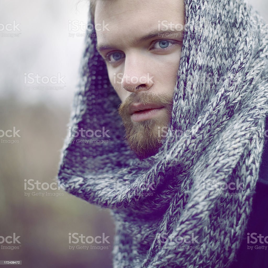 portrait of handsome  young man wearing winter scarf royalty-free stock photo