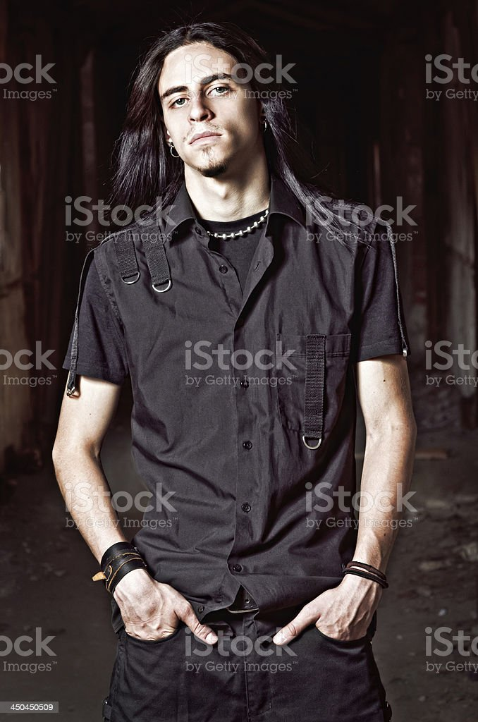 Portrait of handsome young man with long hair stock photo