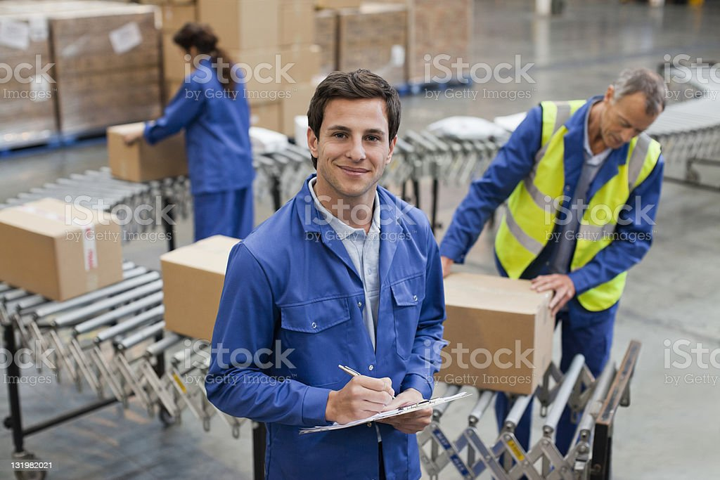 Portrait of handsome young man working in warehouse stock photo